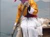 Advanced Colour Prints - First - At the Helm on Lugu Lake by David Newbegin