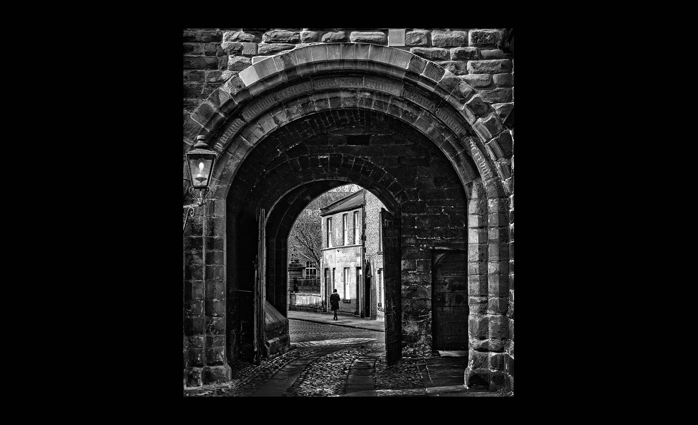 Club Class Mono Prints - Second - Through The Cathederal Arch by Adrian Backhouse
