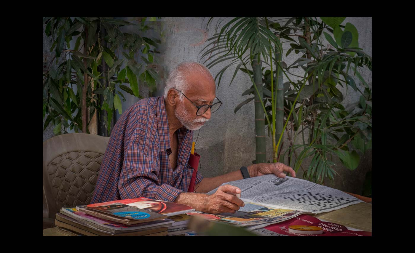 Advanced Colour Prints - C - Indian Reader by Norman Butler