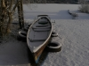 Newcomers Prints - HC - Snow In Boat by Malcolm Iredale