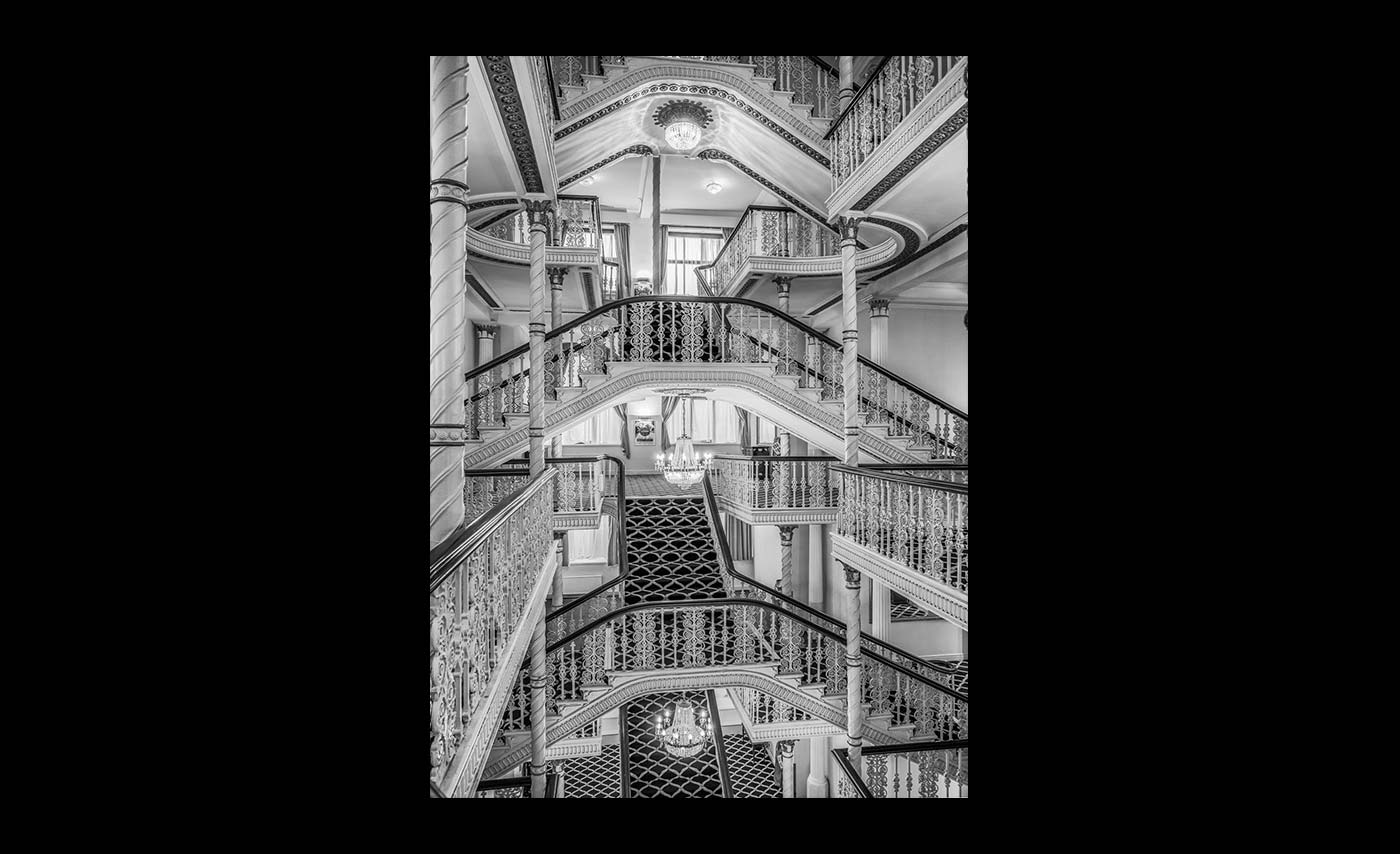 Advanced Monochrome Prints - Third - Hotel Staircase by Norman Butler